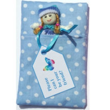 doll in blue sleeping bag